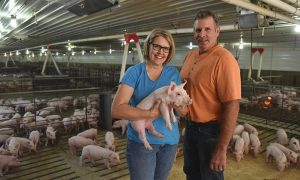 Brad and Peggy Greenway at their pig farm on Thursday, Oct. 6, 2016, in Mitchell, S.D. Greenway is the National Pork Board's Pig Farmer of the Year. (Jay Pickthorn/AP Images for National Pork Board)